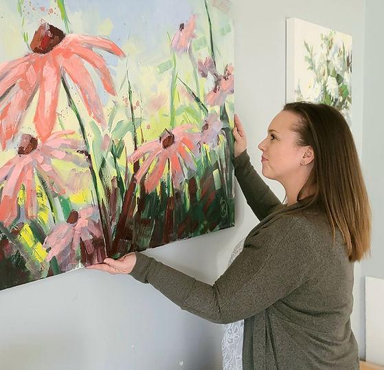 artist-hanging-flower-painting-interior-design