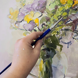 artist's-hand-while-painting-flowers-from-gardens-of-the-south