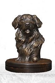 Cast bronze sculpture of a golden retriever by Kindrie Grove
