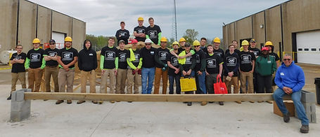 Group photo of the JVS Carpentry Class and a STAR Employee