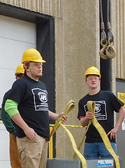 JVS Students waiting to hook an AC unit to the crane
