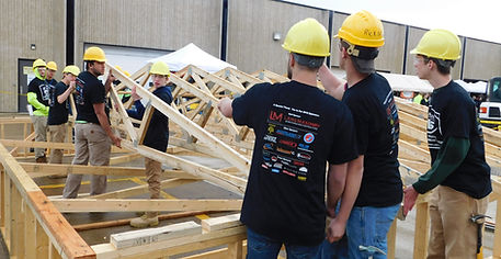 JVS Carpentry Students crafting a makeshift roof