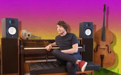 townsppl press shot - piano seated pink bg