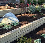 Top soil and hardwood mulch installed in landscape bed