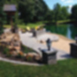 Outdoor hardscape with paver patio and fire pit