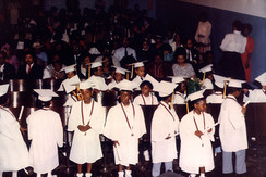 Date of Photograph: ca. 1980s  Graduation ceremony in the EE Cleveland Auditorium.  Physical Attributes: Color (1517 x 1015 px; 96 dpi)  Photo Credit: Courtesy of R.D. Henton Breakthrough Ministries.  R.D. Henton Academy | R.D. Henton Photo Library