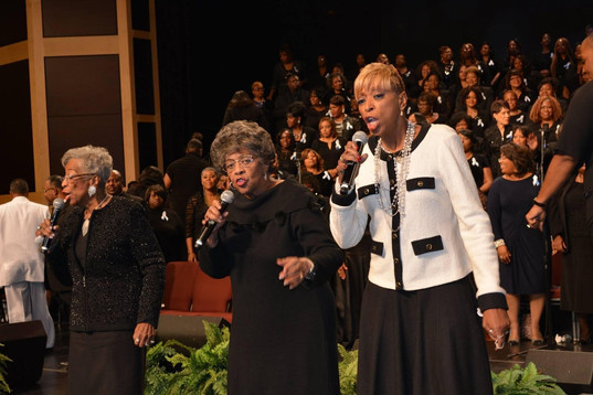 Date of Photograph: ca. October 31, 2015  The Barrett Sisters singing at the National Homegoing Celebration of Apostle Richard D. Henton, held at the House of Hope in Chicago IL.  Physical Attributes: Color (2048 x 1365 px; 96 dpi)  Photo Credit: Courtesy of Rory Trotter Sr.  Going Home | R.D. Henton Photo Library