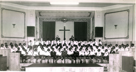 Date of Photograph: ca. 1960s  The Monument of Faith Deliverance Center choir members. Pastor R.D. Henton seated (center), his brother Vernal Henton (left), Bro Claude Timmons (far left), and Timothy Henton (far right).   Physical Attributes: Black and White (2864 x 1527 px; 96 dpi)  Photo Credit: Courtesy of R.D. Henton Breakthrough Ministries.  Monument of Faith Church on Racine   R.D. Henton Photo Library.