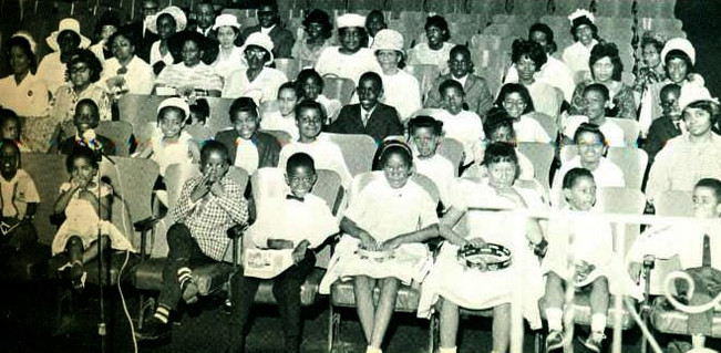 Date of Photograph: ca. 1966  The Sunday School Department of the Monument of Faith Deliverance Center.  Physical Attributes: Black and White (661 x 323 px; 96 dpi)  Photo Credit: Courtesy of R.D. Henton Breakthrough Ministries.  Monument of Faith Church on Racine   R.D. Henton Photo Library.