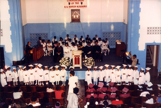 Date of Photograph: ca. 1980s  Graduation ceremony in the EE Cleveland Auditorium.  Physical Attributes: Color (1538 x 1029 px; 96 dpi)  Photo Credit: Courtesy of R.D. Henton Breakthrough Ministries.  R.D. Henton Academy | R.D. Henton Photo Library