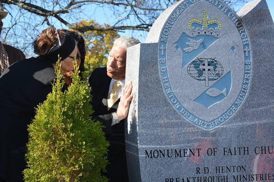 Date of Photograph: ca. November 2, 2015  Funeral director Spencer Leak Sr and Elder Juanita Roberts chat by the grave monument at the internment ceremony.  Physical Attributes: Color (2048 x 1366 px; 96 dpi)  Photo Credit: Courtesy of Rory Trotter Sr.  Going Home | R.D. Henton Photo Library