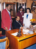 Date of Photograph: ca. 1986  Pastor R.D. Henton and Dr. Donald Henton inside office at the R.D. Henton Academy, pictured with teachers Ms. Lidelle and Ms. Harris.  Physical Attributes: Color (4416 x 5872 px; 96 dpi)  Photo Credit: Courtesy of R.D. Henton Breakthrough Ministries.  R.D. Henton Academy | R.D. Henton Photo Library
