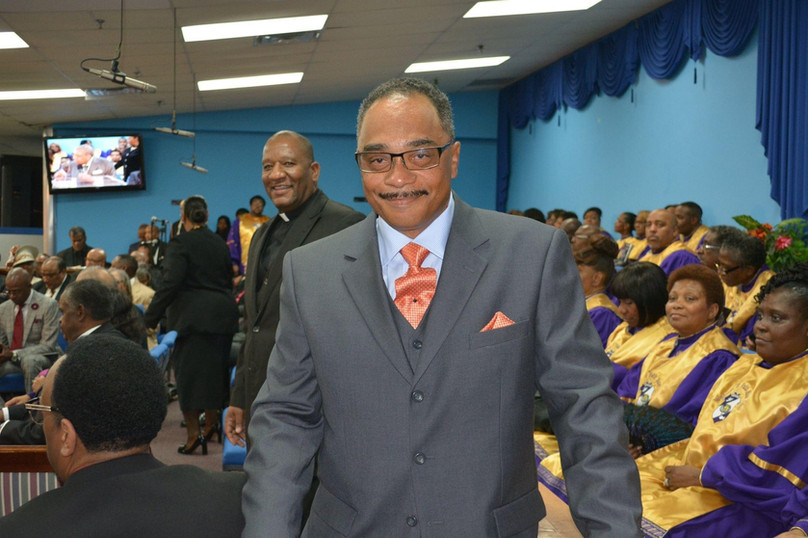 Date of Photograph: ca. October 30, 2015  Bishop John Henton pictured during the Monument of Faith Church Family Homegoing Celebration for Apostle Richard D. Henton  Physical Attributes: Color (2048 x 1365 px; 96 dpi)  Photo Credit: Courtesy of Rory Trotter Sr.  Going Home | R.D. Henton Photo Library