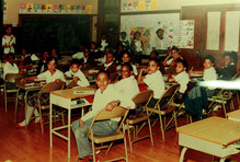 Date of Photograph: ca. 1980s  Inside classroom with students at the R.D. Henton Academy.  Physical Attributes: Color (4908 x 3324 px; 96 dpi)  Photo Credit: Courtesy of R.D. Henton Breakthrough Ministries.  R.D. Henton Academy | R.D. Henton Photo Library