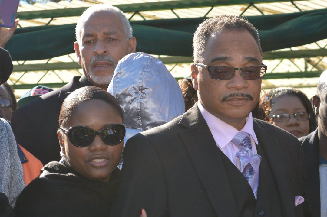 Date of Photograph: ca. November 2, 2015  Bishop John Henton and Lady Lawanda Henton at the internment of Apostle Richard D. Henton.  Physical Attributes: Color (2048 x 1365 px; 96 dpi)  Photo Credit: Courtesy of Rory Trotter Sr.  Going Home | R.D. Henton Photo Library