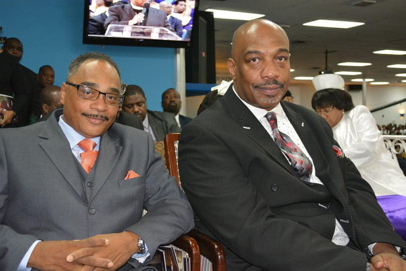 Date of Photograph: ca. October 30, 2015  Pastor Mark Henton (right) and Bishop John Henton (left) at the Monument of Faith Church Family Homegoing Celebration for Apostle Richard D. Henton  Physical Attributes: Color (2048 x 1365 px; 96 dpi)  Photo Credit: Courtesy of Rory Trotter Sr.  Going Home | R.D. Henton Photo Library