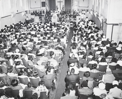 Date of Photograph: ca. 1960s  The congregation inside the Monument of Faith Deliverance Center from the back to the front.  Physical Attributes: Black and White (5090 x 4135 px; 96 dpi)  Photo Credit: Courtesy of R.D. Henton Breakthrough Ministries.  Monument of Faith Church on Racine   R.D. Henton Photo Library.