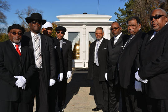 Date of Photograph: ca. November 2, 2015  The Monument of Faith Deacon Board along with Bro. Donald Meeks stand together at the internment of Apostle Richard D. Henton  Physical Attributes: Color (2048 x 1365 px; 96 dpi)  Photo Credit: Courtesy of Rory Trotter Sr.  Going Home | R.D. Henton Photo Library