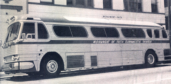 Date of Photograph: ca. 1960s-1970s  The Monument of Faith Evangelistic Church bus parked outside of the Monument of Faith Deliverance Center.  Physical Attributes: Black and White (1343 x 659 px; 96 dpi)  Photo Credit: Courtesy of R.D. Henton Breakthrough Ministries.  Monument of Faith Church on Racine   R.D. Henton Photo Library.