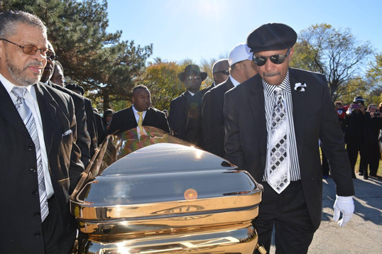 Date of Photograph: ca. November 2, 2015  The Monument of Faith Deacon Board along with Bro. Donald Meeks carry the casket to the burial plot.  Physical Attributes: Color (2048 x 1365 px; 96 dpi)  Photo Credit: Courtesy of Rory Trotter Sr.  Going Home | R.D. Henton Photo Library