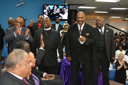 Date of Photograph: ca. October 30, 2015  The ministers roster at the Monument of Faith Church Family Homegoing Celebration for Apostle Richard D. Henton.   Pictured from left to right: Bishop John Henton, Pastor Ray Berryhill, Pastor Mark Henton, Bishop Rory Marshall.   Physical Attributes: Color (2048 x 1365 px; 96 dpi)  Photo Credit: Courtesy of Rory Trotter Sr.  Going Home | R.D. Henton Photo Library