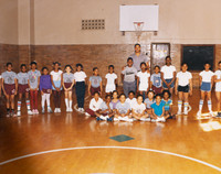 Date of Photograph: ca. 1980s  Inside the school gymnasium with coach and students.  Physical Attributes: Color (5736 x 4529 px; 96 dpi)  Photo Credit: Courtesy of R.D. Henton Breakthrough Ministries.  R.D. Henton Academy | R.D. Henton Photo Library