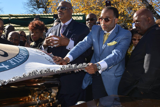 Date of Photograph: ca. November 2, 2015  Randy Glass pictured assisting in draping the Apostle's seal covering over the casket.  Also pictured with Pastor Mark Henton (left) and Bishop Rory Marshall (right).  Physical Attributes: Color (2048 x 1366 px; 96 dpi)  Photo Credit: Courtesy of Rory Trotter Sr.  Going Home | R.D. Henton Photo Library
