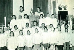 Date of Photograph: ca. 1966  The Monument of Faith Junior choir at the Monument of Faith Deliverance Center.  Physical Attributes: Black and White (535 x 362 px; 96 dpi)  Photo Credit: Courtesy of R.D. Henton Breakthrough Ministries.  Monument of Faith Church on Racine   R.D. Henton Photo Library.