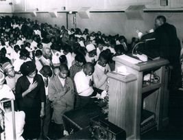 Date of Photograph: ca. 1960s  An altar call made at the Monument of Faith Deliverance Center and Pastor R.D. Henton standing in the pulpit making an appeal.   Physical Attributes: Black and White (2826 x 2151 px; 96 dpi)  Photo Credit: Courtesy of R.D. Henton Breakthrough Ministries.  Monument of Faith Church on Racine   R.D. Henton Photo Library.