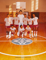 Date of Photograph: ca. 1980s  Inside the school gymnasium with coach and students.  Physical Attributes: Color (4279 x 5629 px; 96 dpi)  Photo Credit: Courtesy of R.D. Henton Breakthrough Ministries.  R.D. Henton Academy | R.D. Henton Photo Library