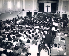 Date of Photograph: ca. 1960s  The congregation inside the Monument of Faith Deliverance Center during offering.  Physical Attributes: Black and White (2940 x 2388 px; 96 dpi)  Photo Credit: Courtesy of R.D. Henton Breakthrough Ministries.  Monument of Faith Church on Racine   R.D. Henton Photo Library.