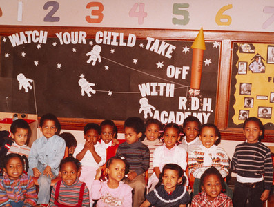 Date of Photograph: ca. 1980s  Inside classroom with students at the R.D. Henton Academy.  Physical Attributes: Color (5716 x 4305 px; 96 dpi)  Photo Credit: Courtesy of R.D. Henton Breakthrough Ministries.  R.D. Henton Academy | R.D. Henton Photo Library