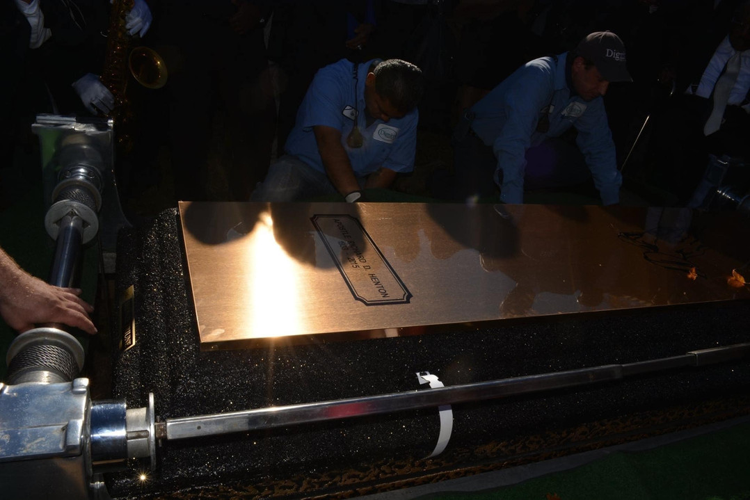 Date of Photograph: ca. November 2, 2015  Cemetery care workers seal the casket inside the burial vault.   Physical Attributes: Color (2048 x 1365 px; 96 dpi)  Photo Credit: Courtesy of Rory Trotter Sr.  Going Home | R.D. Henton Photo Library