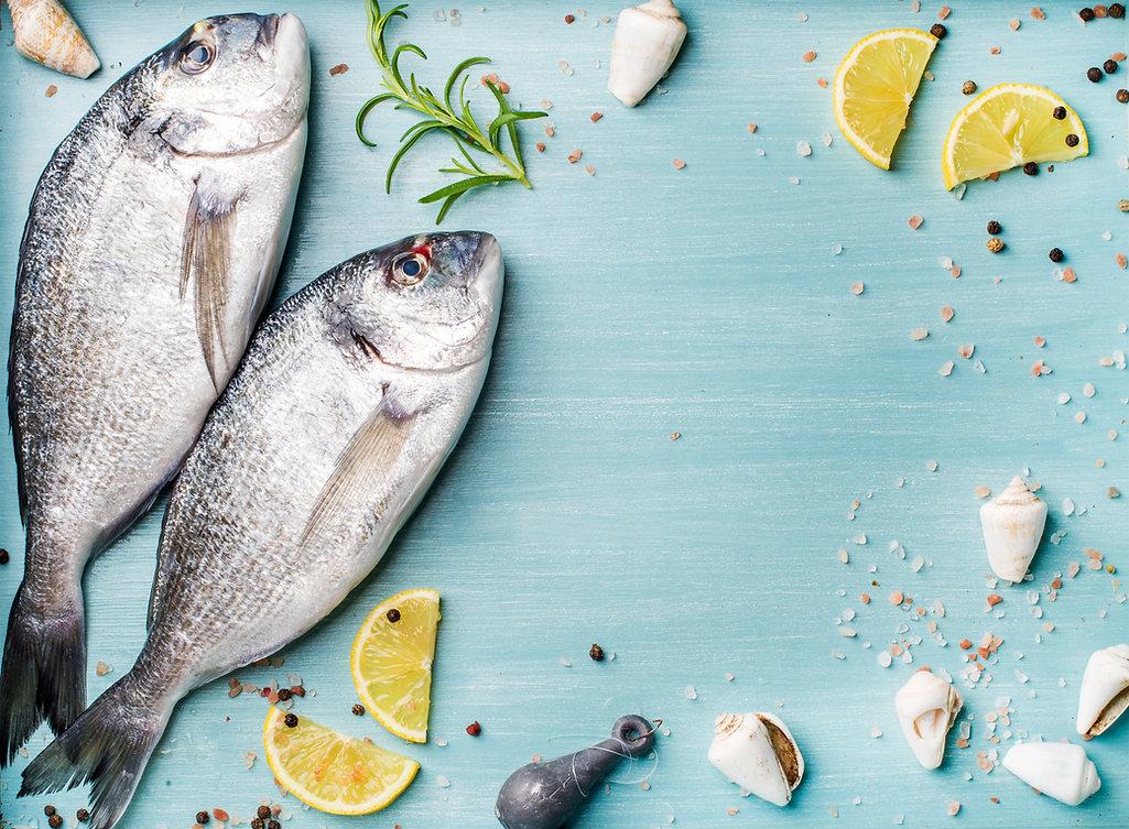 Fresh raw sea bream fish decorated with