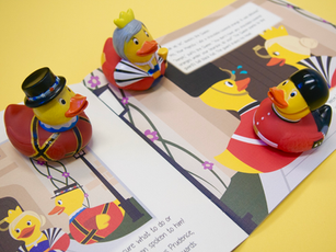 """Image of the three rubber ducks accompanying """"The Queen's Orange Has Appeal"""" on top of a spread."""