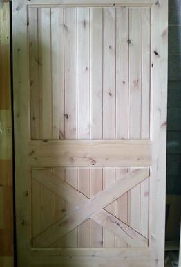 A custom Knotty Alder door we built as a pre-hung barn door
