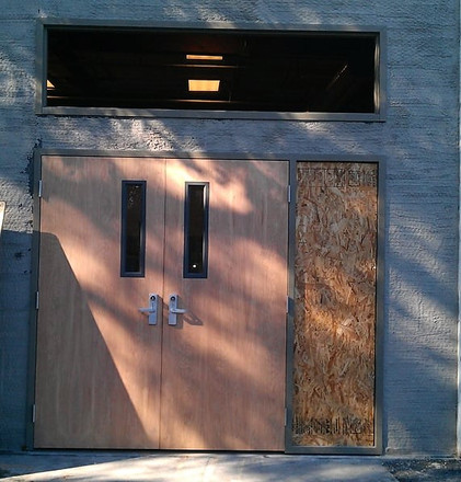 A commercial custom entry unit with a top transom and sidelight, all ADA compliant.
