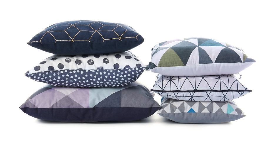 Stylish colorful pillows on white backgr