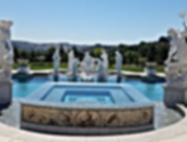 In ground gunite swimming pool & spa with gunite, coping, and simulated stack stone tile completed in Corona, CA.