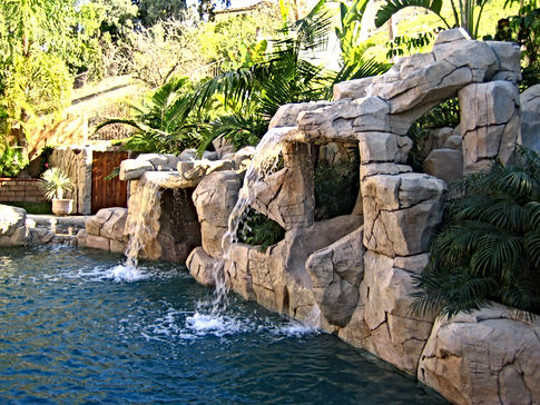 Artificial Rock Waterfall with Rock Slide into Swimming Pool