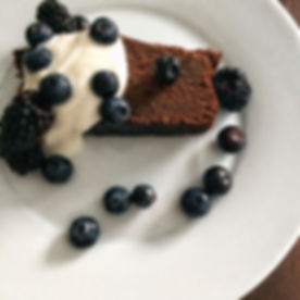 Chocolate chickpea cake with berries and a dollop of maple yogurt.jpg