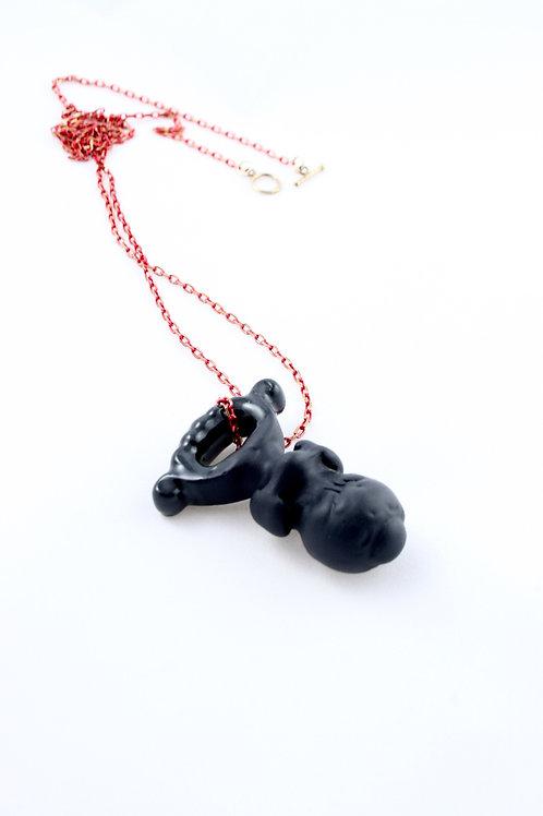 """""""Sucker"""" black pendant red chain"""