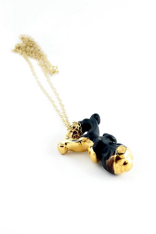 """Sucker"" black gold pendant"