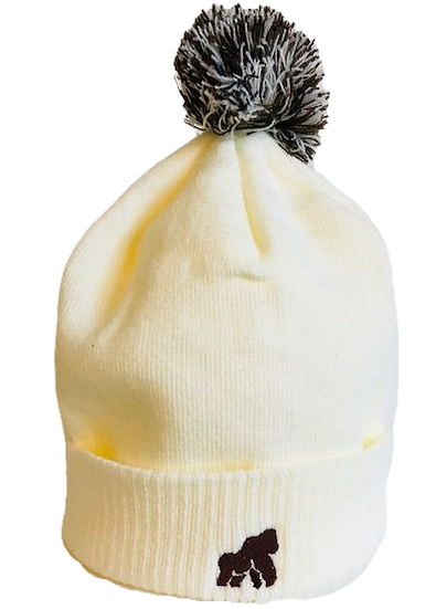 cream/white winter hat with a brown logo in centre
