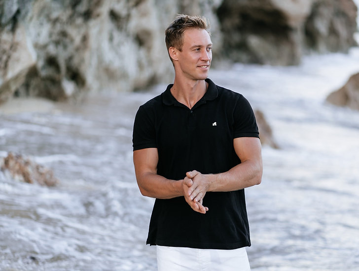 model in black adult polo t-shirt with a white logo