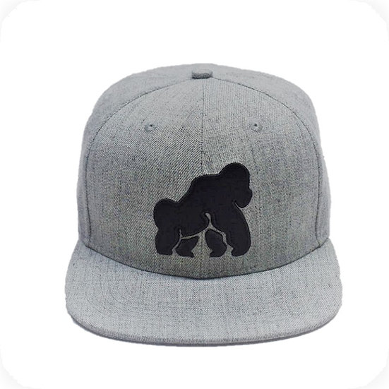 front view of grey snapback with black ape on front
