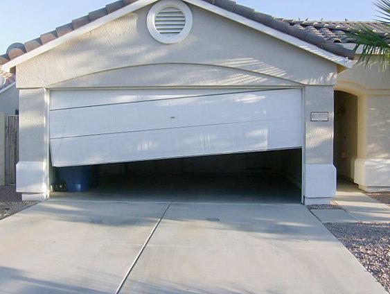 Garage door off track denver co family garage door llc garage door off track door off track colorado garage door company colorado garage solutioingenieria Images