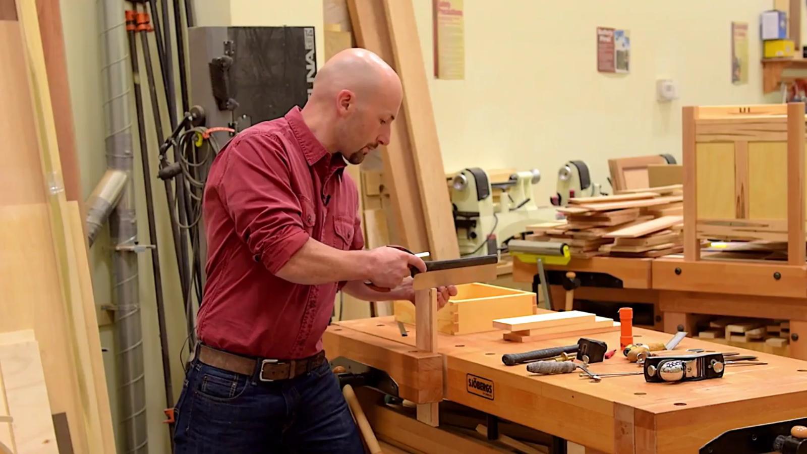 Andrew Teixeira cuts dovetails