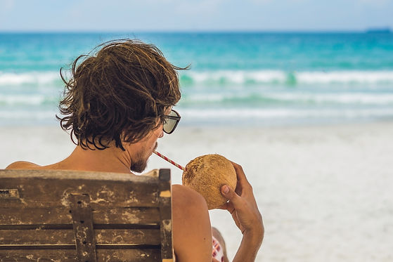 Man drinking Young coconut