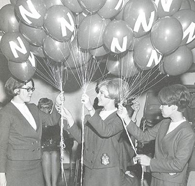 The Tassels prepare balloons pregame.